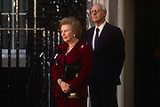 British Prime Minister, Margaret Thatchers political career of 11 years ends emotionally on the steps of 10 Downing Street after being deposed in a leadership challenge, on 28th November 1990 in London, England. Standing close behind her is Thatchers husband and lifelong confidente, Dennis.