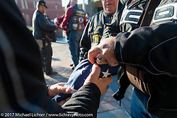 Folding the flag at the Harley-Davidson rally point for the kickoff of the USS South Dakota submarine flag relay across South Dakota. Sturgis, SD. USA. Saturday October 7, 2017. Photography ©2017 Michael Lichter.