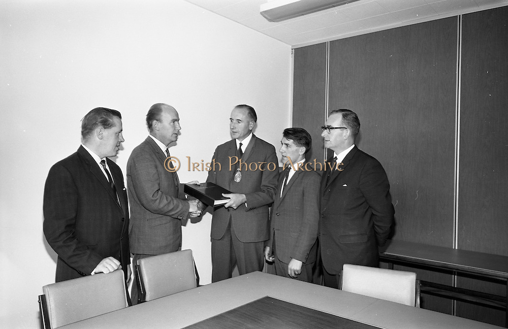 3/11/1967<br /> 11/3/1967<br /> 3 November 1967<br /> <br /> Presentation of the Irish Hardware Associations Postal Course to Junior Assistants was made to the Minister of Labour Dr. P. J. Hillery T.D. at the Dept. of Labour in Dublin.<br /> <br /> Picture shows Mr. John Donegal F.N.I.H. Member of the Executive Council; The Minister of Labour Dr. P.J. Hillery T.D. Mr. Charles Wilson 1st Vice President of I.H. Association; Mr. Vincent Maher F.N.I.H. Member of the Executive Council I.H Association and Mr Terence D. Spillane F.N.I.H. Secretary Irish Hardware Association