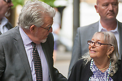 London, May 21st 2014. Entertainer Rolf Harris arrives with his wife Alwen at Southwark Crown Court where his trial on 12 counts of indecent assault against girls aged between 7 and 19 continues.