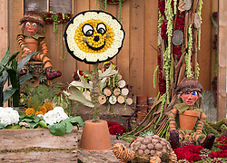 © Licensed to London News Pictures. 08/07/2013. London, UK. A 'Bill and Ben the Flowerpot Men' display, complete with 'Little Weed' is seen in the 'Roses and Floristry Vintage Festival' at the press view for the Royal Horticultural Society's Hampton Court Palace Flower Show today (08/07/2013). Photo credit: Matt Cetti-Roberts/LNP