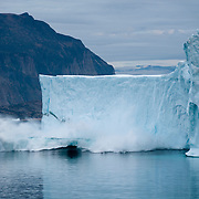 A piece of an iceberg breaks off which is known as calving. Greenland