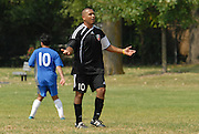 Edgar Salgado (#10) argues a call on the field while competing against Team Shlama F.C. during National Soccer League play in Skokie, Il.