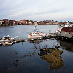 Portsmouth, New Hampshire and the Piscataqua River from the US 1 Bridge (Memorial Bridge.)  Boats in the foreground are in Kittery, Maine.