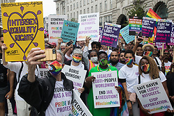 Peter Tatchell, veteran LGBTI+ and human rights campaigner, takes a selfie with some of the thousands of LGBTI+ protesters taking part in the first-ever Reclaim Pride march on 24th July 2021 in London, United Kingdom. Reclaim Pride replaced the traditional Pride in London march, which many feel has become too commercial and strayed from its roots in protest, and was billed as a People's Pride march for LGBTI+ liberation. Campaigners called for the banning of LGBTI+ conversion therapy, the reform of the Gender Recognition Act, the provision of a safe haven for LGBTI+ refugees and for LGBTI+ people to be decriminalised worldwide and marched in solidarity with Black Lives Matter.