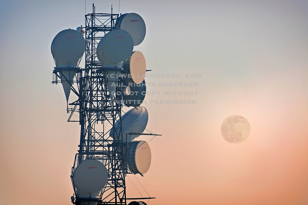 Moonrise and microwave tower, eastern Washington, Pacific Northwest by Randy Wells
