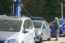 © Licensed to London News Pictures 24/09/2021.<br /> Eltham, UK, Motorists queuing for up to an hour at Sainsbury's petrol station in Eltham, South East London. Chaos at the forecourts as people start to panic buy petrol. BP has started to ration petrol and diesel due to a shortage of truckers. Photo credit:Grant Falvey/LNP