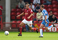 Photo: Daniel Hambury.<br />Walsall v Swindon. Coca Cola League 1.<br />03/09/2005.<br />Swindon's Gareth Whalley and Walsall's Paul Merson compete for the ball