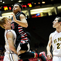 031214  Adron Gardner/Independent<br /> <br /> Grants Pirate Lionel Money (35) draws a blocking foul from St. Pius X Sartan Ray Reyes (32) during the state high school basketball tournament at The Pit in Albuquerque Wednesday.