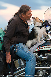 Ed Reiken of Kingston Springs, TN with his dog Jaxson at Heather and Chris Callen's Wedding at the Broken Spoke Camground during the 75th Annual Sturgis Black Hills Motorcycle Rally.  SD, USA.  August 8, 2015.  Photography ©2015 Michael Lichter.
