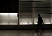 A person walks in the tunnel of the Potsdamer Platz train station in Berlin, Germany, April 06, 2012.