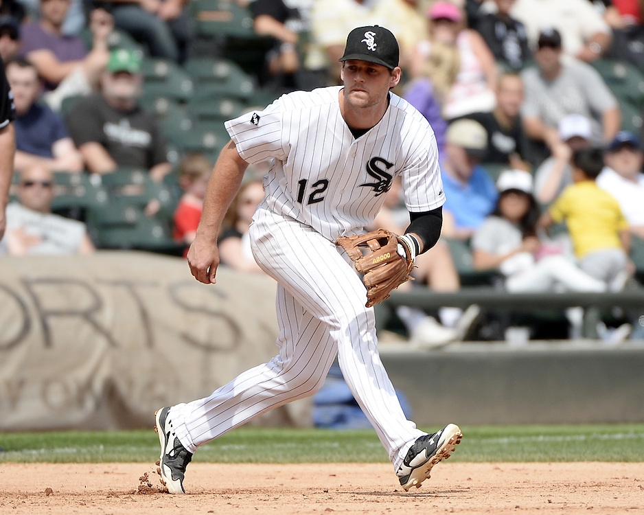 CHICAGO - AUGUST 06:  Conor Gillaspie #12 of the Chicago White Sox fields against the Texas Rangers on August 6, 2014 at U.S. Cellular Field in Chicago, Illinois.  (Photo by Ron Vesely)