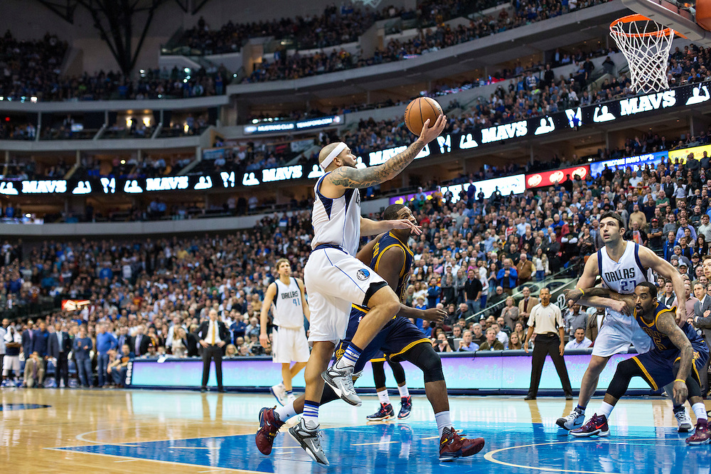 DALLAS, TX - JANUARY 12:  Deron Williams #8 of the Dallas Mavericks goes up for a lay up during a game against the Cleveland Cavaliers at American Airlines Center on January 12, 2016 in Dallas, Texas.  NOTE TO USER: User expressly acknowledges and agrees that, by downloading and or using this photograph, User is consenting to the terms and conditions of the Getty Images License Agreement.  The Cavaliers defeated the Mavericks 110-107.  (Photo by Wesley Hitt/Getty Images) *** Local Caption *** Deron Williams