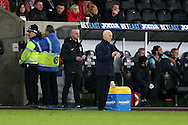 Swansea city manager Bob Bradley checks his watch as his team go 1-4 down. Premier league match, Swansea city v West Ham United at the Liberty Stadium in Swansea, South Wales on Boxing Day, Monday 26th December 2016.<br /> pic by  Andrew Orchard, Andrew Orchard sports photography.
