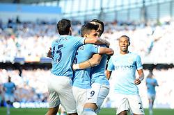Manchester City's Sergio Aguero celebrates with his team mates after scoring. - Photo mandatory by-line: Dougie Allward/JMP - Tel: Mobile: 07966 386802 22/09/2013 - SPORT - FOOTBALL - City of Manchester Stadium - Manchester - Manchester City V Manchester United - Barclays Premier League
