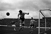 25/04/1965<br /> 04/25/1965<br /> 25 April 1965<br /> F.A.I. Cup Final: Shamrock Rovers v Limerick at Dalymount Park, Dublin. Mulligan (Shamrock Rovers) turns the ball around the post to give Limerick a corner. On left is Limerick forward Mulvey and Shamrock Rovers goalie Smyth on right.