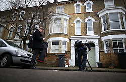 © Licensed to London News Pictures. 11/01/2016. London, UK. Reporters gather at the Brixton house that David Bowie lived in. The Death of David Bowie, who was born in Brixton, has been announced today.  Photo credit: Peter Macdiarmid/LNP
