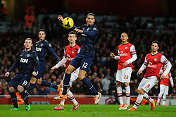 Man Utd Defender Chris Smalling (ENG) fails to connect with a cross - Photo mandatory by-line: Rogan Thomson/JMP - 07966 386802 - 12/02/14 - SPORT - FOOTBALL - Emirates Stadium, London - Arsenal v Manchester United - Barclays Premier League.