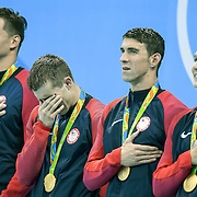 United States swimmer Ryan Held, second from left, broke down in tears during the National Anthem with 4x100m relay teammates Nathan Adrian, left, Michael Phelps, second from right, and Caeleb Dressel, left, following their gold medal victory at the 2016 Summer Olympics Games in Rio de Janeiro, Brazil.