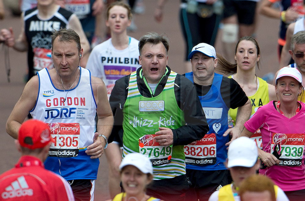 © London News Pictures. 22/04/2012. London, UK. Labour MP Ed Balls approaches the finnish line at the 2012 Virgin London Marathon in London on April 22, 2012. Photo credit : Ben Cawthra /LNP