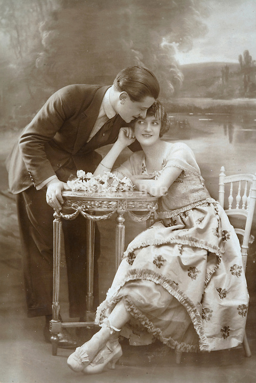 romantic portrait of young couple about to kiss each other 1920s