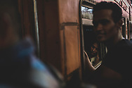 A Sri Lankan woman rests inside a train that will soon depart Fort railway station in Colombo for the city of Kandy. (April 1, 2017)