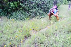 Hiker exploring along trail to Scyene Overlook, Great Trinity Forest, Dallas, Texas, USA