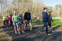 Students, parents and faculty walk the newly dedicated walking path at Pleasant Street School on Wednesday morning.  (Karen Bobotas/for the Laconia Daily Sun)