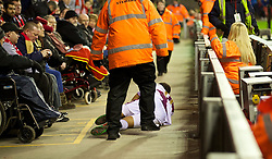 18.01.2014, Anfield, Liverpool, ENG, Premier League, FC Liverpool vs Aston Villa, 22. Runde, im Bild Aston Villa's Gabriel Agbonlahor ends up, the Spion Kop after falling over the advertising hoardings // during the English Premier League 22th round match between Liverpool FC and Aston Villa at Anfield in Liverpool, Great Britain on 2014/01/18. EXPA Pictures © 2014, PhotoCredit: EXPA/ Propagandaphoto/ David Rawcliffe<br /> <br /> *****ATTENTION - OUT of ENG, GBR*****