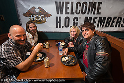 A Sunday night HOG welcome party at the Full Moon Saloon included a pulled pork dinner and a couple of drinks during the Daytona Bike Week 75th Anniversary event. FL, USA. Sunday March 6, 2016.  Photography ©2016 Michael Lichter.