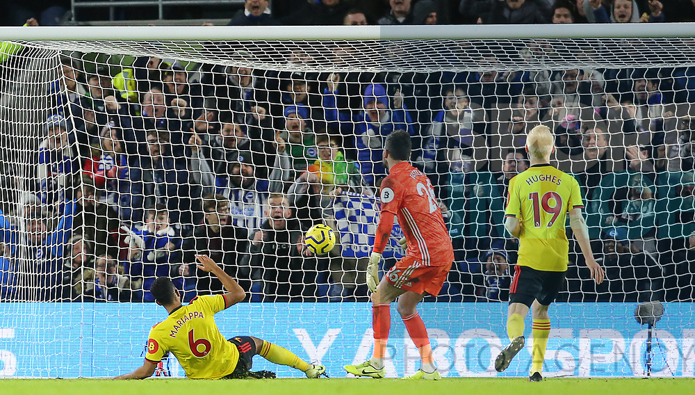 Watford's Adrian Mariappa scores an own goal to make it 1-1 during the Premier League match at the American Express Community Stadium, Brighton and Hove. Picture date: 8th February 2020. Picture credit should read: Paul Terry/Sportimage