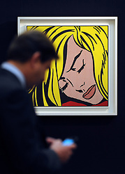 © Licensed to London News Pictures. 12/04/2012. London, UK . A man uses his mobile phone in front of Roy Lichtenstein's 'Sleeping Beauty' which is expected to fetch 30 - 40 million US dollars. Photocall for Sotheby's Impressionist and Modern Art Evening Sale 12 April 2012. Photo credit : Stephen Simpson/LNP