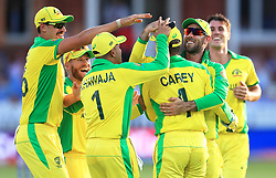 Australia's Alex Carey (centre) celebrates after the catch of New Zealand's Ross Taylor with team-mates during the ICC Cricket World Cup group stage match at Lord's, London.