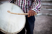 """Father Abdush during a drum session on a stage in front of the """"House of Culture"""" in Delcevo, Macedonia. The Roma family - father and his 3 sons - are well know for their drum perfomances and also they build their drums themselves."""
