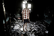An Indian Christian boy returns to his house damaged during the riots run by hardline Hindu activists in Orissa's Kandhamal district some 350 kms southwest of Bhubaneswar, in october 2008.  Nov. 11, 2008.