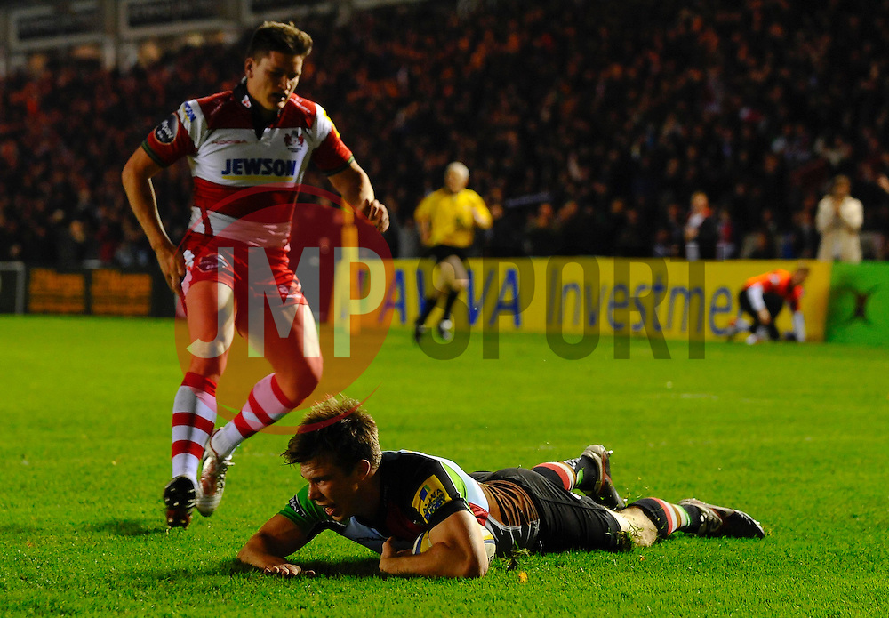 Harlequins Winger (#11) Sam Smith scores his sides 3rd try as Gloucester Fly-Half (#10) Freddie Burns chases during the first half of the match - Photo mandatory by-line: Rogan Thomson/JMP - Tel: Mobile: 07966 386802 03/11/2012 - SPORT - RUGBY - Twickenham Stoop - London. Harlequins v Gloucester - Aviva Premiership