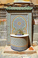 Tiled Arabesuqe Berber street fountain wells of the Medina. A UNESCO World Heritage Site. Meknes, Meknes-Tafilalet, Morocco .<br /> <br /> Visit our MOROCCO HISTORIC PLAXES PHOTO COLLECTIONS for more   photos  to download or buy as prints https://funkystock.photoshelter.com/gallery-collection/Morocco-Pictures-Photos-and-Images/C0000ds6t1_cvhPo<br /> .<br /> <br /> Visit our ISLAMIC HISTORICAL PLACES PHOTO COLLECTIONS for more photos to download or buy as wall art prints https://funkystock.photoshelter.com/gallery-collection/Islam-Islamic-Historic-Places-Architecture-Pictures-Images-of/C0000n7SGOHt9XWI