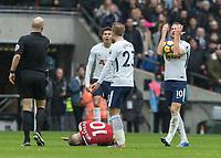 Football - 2017 / 2018 Premier League - Tottenham Hotspur vs. Arsenal<br /> <br /> Harry Kane (Tottenham FC)  protests after he is adjudged to have fouled Jack Wilshere (Arsenal FC) <br /> at Wembley Stadium.<br /> <br /> COLORSPORT/DANIEL BEARHAM