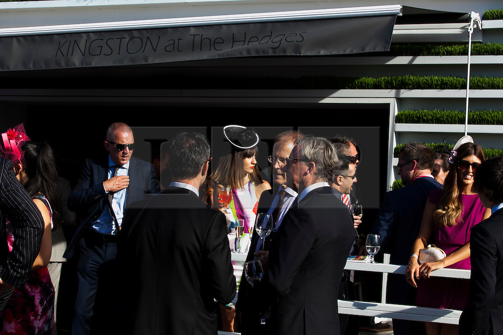 © Licensed to London News Pictures. 5/11/2013. VIP members in the exclusive Birdcage area have a drink in the late afternoon sun  during Melbourne Cup Day at Flemington Racecourse on November 5, 2013 in Melbourne, Australia. Photo credit : Asanka Brendon Ratnayake/LNP