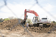 Speelman Excavation moves dirt after demolishing the 76 gas station at the corner of Serra Way and Calaveras Blvd, Milpitas, Calif., on Aug. 3, 2012.  According to construction workers, another gas station will be built.  Photo by Stan Olszewski/SOSKIphoto.