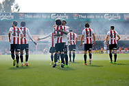Brentford players celebrate a goal from Brentford midfielder Jota (23) (score 2-0) during the EFL Sky Bet Championship match between Brentford and Queens Park Rangers at Griffin Park, London, England on 22 April 2017. Photo by Andy Walter.