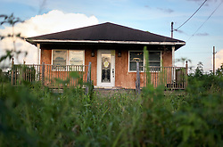 20 August 2015. New Orleans, Louisiana. <br /> Hurricane Katrina revisited. <br /> A decade later and recovery remains largely elusive for the area hardest hit by Katrina. An abandoned building flooded in the storm remains unprepared and in disrepair.<br /> Photo credit©; Charlie Varley/varleypix.com.