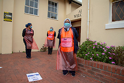 Parkwood, Cape Town, South Africa: Community health workers at a church now designated as a testing site, as the government is now doing door-to-door COVID-19 screenings in Parkwood, a suburb of Cape Town on the Cape Flats, on Thursday, April 16, 2020. The Western Cape government is ramping up mass screening and testing to stop the spread in vulnerable communities, such as low-income areas where many are living in multi-family households in crowded spaces. The aim is early detection, so that those who are testing positive can be removed to quarantine elsewhere. PHOTO: EVA-LOTTA JANSSON