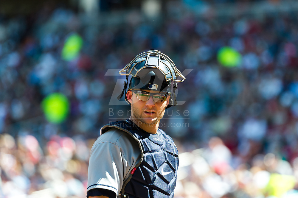 Cleveland Indians catcher Lou Marson looks into the Indians dugout during a game against the Minnesota Twins at Target Field in Minneapolis, Minnesota on July 29, 2012.  The Twins defeated the Indians 5 to 1.  © 2012 Ben Krause
