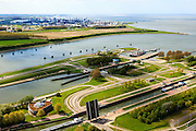 Nederland, Zeeland, Terneuzen, 09-05-2013; Sluizencomplex Terneuzen gezien in de richting van de Westerschelde. Binnenvaartschepen verlaten de Oostsluis of binnenvaartsluis.  Dow Cemicals in de achtergrond.<br /> View on the sluices of Terneuzen in the direction of the Westerschelde. Barges leaving the  canal sluice (Oostsluis). View on the sluices of Terneuzen. Dow Cemicals in the back.<br /> luchtfoto (toeslag op standard tarieven)<br /> aerial photo (additional fee required)<br /> copyright foto/photo Siebe Swart