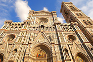 The Dome Cathederal - Detail Of facade and bell tower ; Florence Italy .<br /> <br /> Visit our ITALY PHOTO COLLECTION for more   photos of Italy to download or buy as prints https://funkystock.photoshelter.com/gallery-collection/2b-Pictures-Images-of-Italy-Photos-of-Italian-Historic-Landmark-Sites/C0000qxA2zGFjd_k<br /> .<br /> <br /> Visit our MEDIEVAL PHOTO COLLECTIONS for more   photos  to download or buy as prints https://funkystock.photoshelter.com/gallery-collection/Medieval-Middle-Ages-Historic-Places-Arcaeological-Sites-Pictures-Images-of/C0000B5ZA54_WD0s