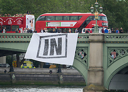 © Licensed to London News Pictures. 15/06/2016. London, UK. EU remain campaigners hold an IN banner of Westminster Bridge as campaigners converge on the Thames near Parliament. Photo credit: Peter Macdiarmid/LNP