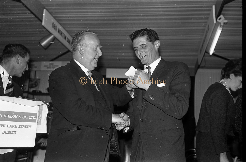 19/01/1963<br /> 01/19/1963<br /> 19 January 1963<br /> Lord mayor draws raffle prizewinner at Mansion House, Dublin.  At the conclusion of the Irish Hotel and Catering Trades Exhibition at the Mansion House, Lord Mayor Alderman J.J. O'Keeffe, T.D., P.C. drew the winning ticket in aid of the Royal Hospital for Incurables, Donnybrook, Dublin for a Lanson Black Label Methuselah, presented by Edward Dillon and Co. Ltd. The proceeds of £50 were presented to the Mayor for donation to the hospital. Picture shows the Lord mayor (left) receiving a cheque  of the proceeds of the draw from Mr Nigel Beamish, Director of Edward Dillon and Co. Ltd, North Earl Street, Dublin.