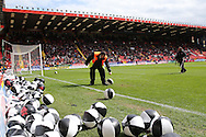 stewards clear after Charlton Athletic fans protesting by throwing balloons and black and white beach balls to disrupt the match being kicked off.  Skybet football league championship match, Charlton Athletic v Brighton & Hove Albion at The Valley  in London on Saturday 23rd April 2016.<br /> pic by John Patrick Fletcher, Andrew Orchard sports photography.