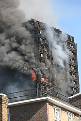 White City Tower Block Wednesday 14th June 2017 Several people have died after a huge fire raged through the night at a west London tower block, a fire chief says.<br /> Firefighters are still tackling the blaze at Grenfell Tower in north Kensington, where eyewitnesses said people were trapped inside, screaming for help.<br /> <br /> More than 50 people are being treated in hospital, says London Ambulance.©UKNIP